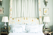 A garden-themed bedroom with a canopied bed