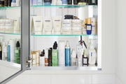 A bathroom cabinet full of products.