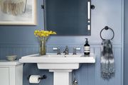 Blue bathroom with tiled floor.