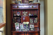 An armoire with bookcase in a library