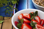A bowl of strawberries on a festive outdoor table