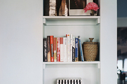 Books and decorative accessories on built-in shelves