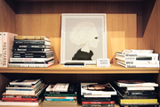Autographed copies of art books in a wooden bookcase