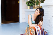 Mia Maestro seated on her front porch