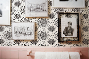 Sketches by Albert Hadley and a signed portrait of Martha Stewart on Hadley's fireworks-print wallpaper