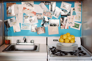 A backsplash converted to an inspiration board in a small kitchen