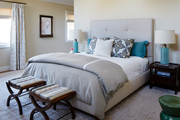 Contemporary gray and yellow bedroom with blue accents.