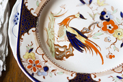 Hand-painted china on a wooden dining table