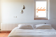 Lighting designed by Alvar Aalto in a Danish-inspired guest room