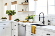 A kitchen with a clean black and white color palette.