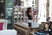 Furniture, rugs, and candles in a retail environment