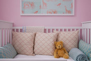 A toddler bed dressed in pillows by Loom Decor