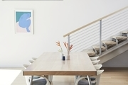 The designer keeps her aesthetic minimal and refined, accenting communal spaces with unique artworks, like the blue nude — entitled The Bathers 14, by New York-based artist, Piero Passacantando — sourced via Uprise Art — situated in the dining area.
