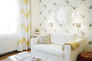 Printed wallpaper and chevron curtains in a living room