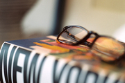 A pair of eyeglasses resting on a book