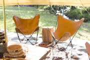 A pair of butterfly chairs at the craft area.