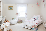 A whimsical kid's bedroom with pink accents.