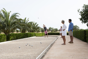 Playing pétanque, a bocce-like game, on a landscaped Majorca estate