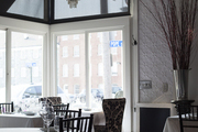 Pressed-tin walls and a crystal chandelier at Tallulah on Thames