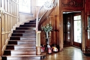 A stately entryway with wooden walls.