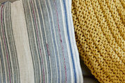 A textural combination of a pillow and throw