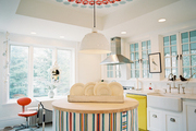 A round island with a colorful striped skirt