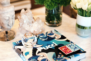 Coffee table styling with flowers, books, and decorative accessories