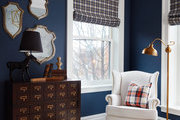 Eclectic vintage furniture in bright children's room.