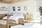 "There are few beach houses (or houses in general) that compare to the streamlined, waterfront home owned by Lunya founder Ashley Merrill, her husband Marc, and their young family. With three beautifully minimalist bedrooms and adhering to a refreshingly pared-down style code, it's little wonder why this sweet SoCal home sparks a whole lot of joy for the luxury sleepwear entrepreneur. ""Home time is my favorite time of day,"" says Merril. ""My brand, Lunya, and my love of decor are testament to this. My minimal approach to design runs throughout my home and sleepwear line, because I want the environment to support a clear mind and organized thoughts. When I have fewer things, it allows me to focus on what's important."""