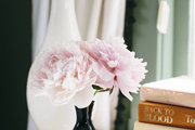 Ruffled blooms on a nightstand next to a table lamp