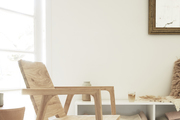A wooden chair grounds a built-in bench look.