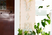 Wall hangings and hanging plants near a front door