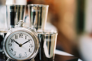 Silver cups and an alarm clock on a black platform