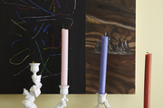 Colorful candlesticks on a black mantel