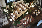 Hors d'oeuvres and wooden serving trays atop wood table.