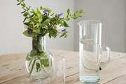 Tablescape featuring glassware, a pitcher, and a vase