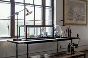 A simple bench, worktable, and lamp evoke industrial- age utilitarianism at American Street Showroom