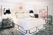 Zebra-print carpeting and an abundance of art in a black-and-white bedroom