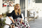 Molly Sims sits on a bench outside of her pool house