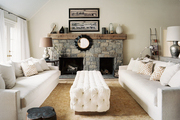 A tufted upholstered ottoman paired with two couches