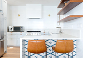 A contemporary kitchen with blue and white tile.