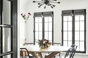 A contemporary dining space with black accents