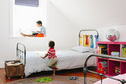 Twin beds in a colorful kids room