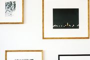 Framed black-and-white photographs on a white wall