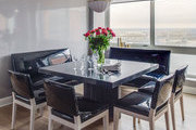 A modern dining room with patent leather seating