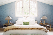 Blue floral wallpaper and a green bench in a bedroom with a cathedral ceiling