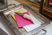 A vintage silver tray collects mail