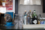 A bar display stocked with favorite liquors and glassware