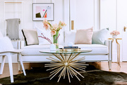 A detail of a glam living space with pink and gold details.