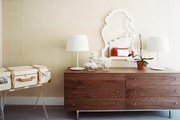 A wood dresser accented with white accessories
